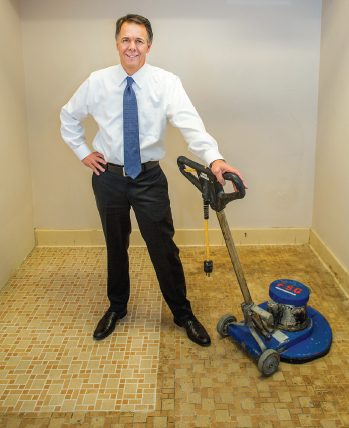 Chip Grimes demonstrating tile cleaning service